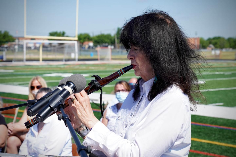 Joy playing flute