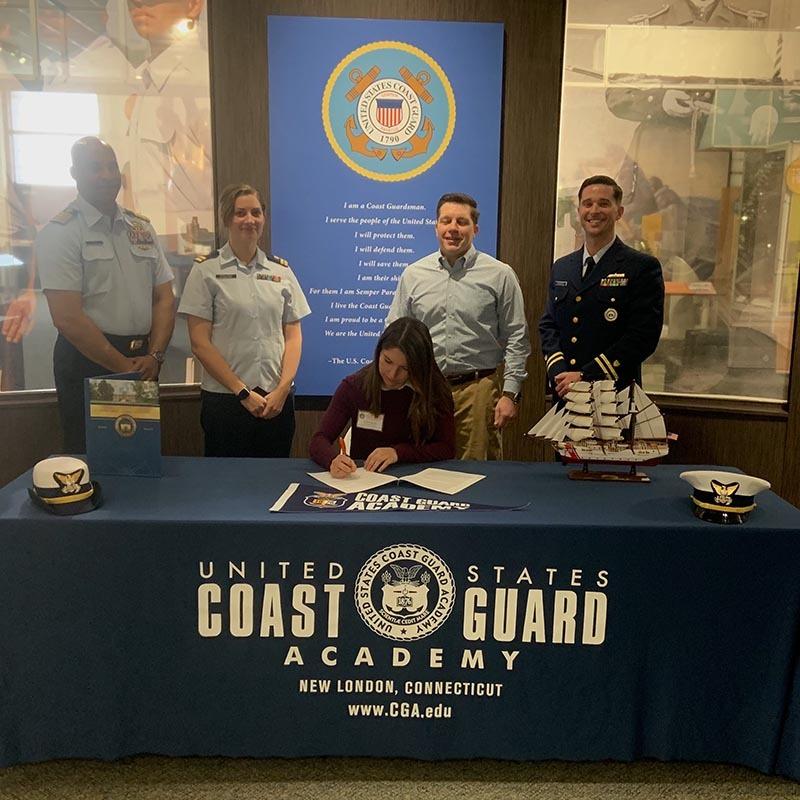 Leonora signs w Coast Guard